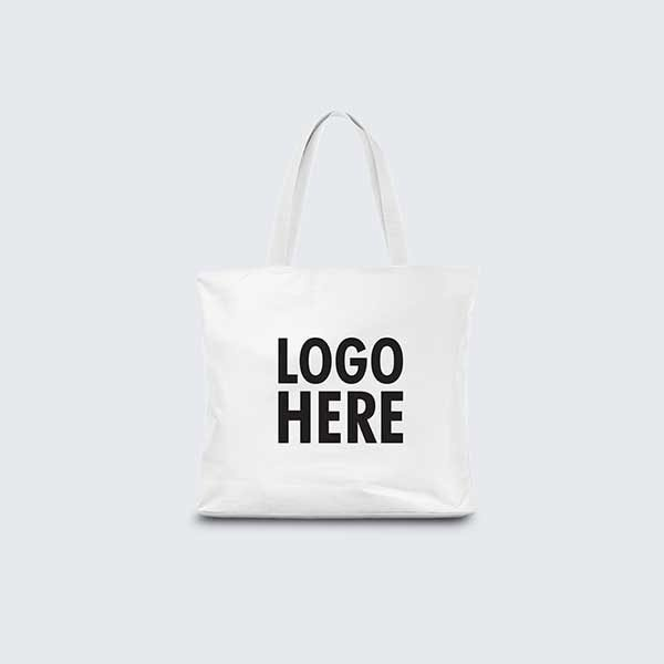 Blank canvas tote bag isolated on white background